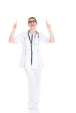 Beautiful young woman doctor pointing up. Royalty Free Stock Images