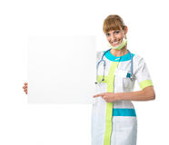 Beautiful young woman doctor  showing blank board Stock Images
