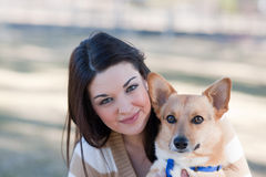 Beautiful young woman with a dog Stock Photos