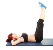 Beautiful young woman doing exercise, full length Stock Photography