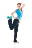 The beautiful young woman doing exercise isolated Stock Images