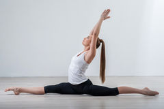 young girl doing splits while warming up stock photo