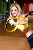 Beautiful young woman doing exercises. In the gym Royalty Free Stock Photography