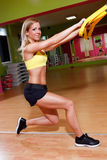 Beautiful young woman doing exercises. In the gym Royalty Free Stock Photos