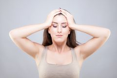 Beautiful young woman doing face yoga pose Stock Photos