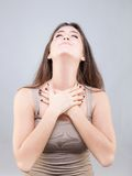 Beautiful young woman doing face yoga pose Stock Image