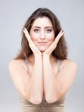 Beautiful young woman doing face yoga pose Royalty Free Stock Image