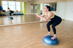 Beautiful young woman doing fitness in the gym Stock Image
