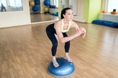 Beautiful young woman doing fitness in the gym Royalty Free Stock Image