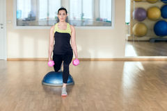 Beautiful young woman doing fitness in the gym Royalty Free Stock Photography