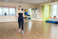 Beautiful young woman doing fitness in the gym Stock Photo