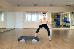 Beautiful young woman doing fitness in the gym Royalty Free Stock Images