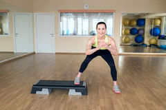 Beautiful young woman doing fitness in the gym Stock Images