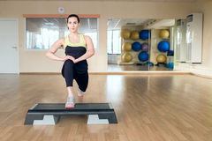 Beautiful young woman doing fitness in the gym Royalty Free Stock Photos