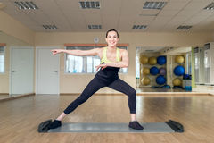 Beautiful young woman doing fitness in the gym Royalty Free Stock Photo