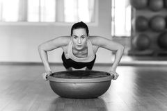 Beautiful young woman doing fitness in the gym Stock Photography