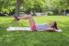Beautiful young woman doing gym outdoors Stock Image