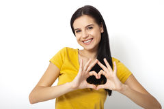 Beautiful young woman doing heart shape with her hands isolated Royalty Free Stock Photography
