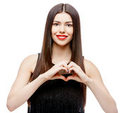Beautiful young woman doing a heart shape with her hands Royalty Free Stock Images