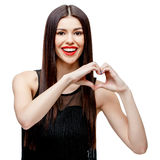 Beautiful young woman doing a heart shape with her hands Royalty Free Stock Photography