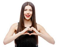 Beautiful young woman doing a heart shape with her hands Royalty Free Stock Photo