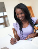 Beautiful young woman doing her homework Stock Images