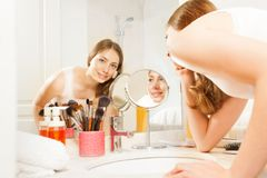 Free Beautiful Young Woman Doing Her Makeup In Bathroom Royalty Free Stock Photos - 104314508
