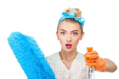 Beautiful young woman is doing housework Stock Photography