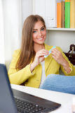 Beautiful young woman doing manicure Stock Images