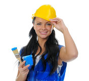 Beautiful young woman doing repairs Stock Image