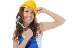 Beautiful young woman doing repairs Royalty Free Stock Images