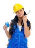 Beautiful young woman doing repairs Royalty Free Stock Image