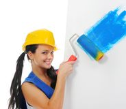 Beautiful young woman doing repairs Stock Images