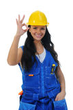 Beautiful young woman doing repairs Stock Photo