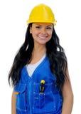 Beautiful young woman doing repairs Stock Photo