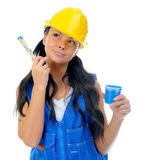 Beautiful young woman doing repairs Royalty Free Stock Photo