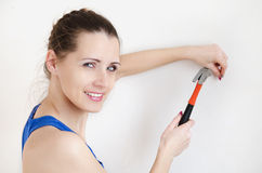 Beautiful young woman doing repairs Stock Image