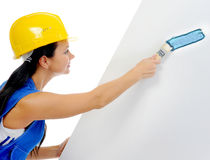 Beautiful young woman doing repairs Royalty Free Stock Image