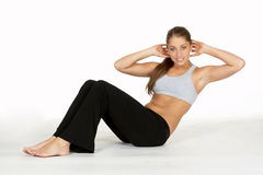 Beautiful Young Woman Doing Stomach Crunch Stock Photo