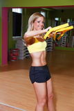 Beautiful young woman doing TRX exercise Stock Photos