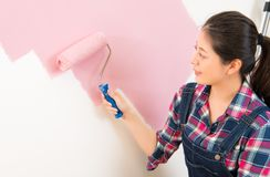 Beautiful young woman doing wall painting Royalty Free Stock Photography