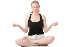 Beautiful young woman doing yoga exercise Stock Photography