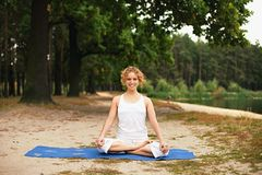 Beautiful young woman doing yoga exercise Royalty Free Stock Images