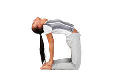 Beautiful young woman doing yoga exercise. Royalty Free Stock Photos