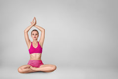 Beautiful young woman doing yoga exercise Stock Photos