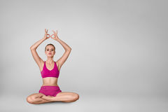 Beautiful young woman doing yoga exercise Royalty Free Stock Photo