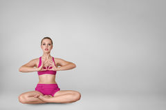 Beautiful young woman doing yoga exercise Stock Image