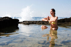 Beautiful young woman doing yoga at the sea Royalty Free Stock Image
