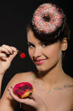 Beautiful young woman with donut and berries Stock Image