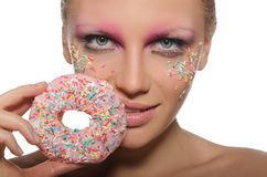 Beautiful young woman with donut in mouth Royalty Free Stock Photography